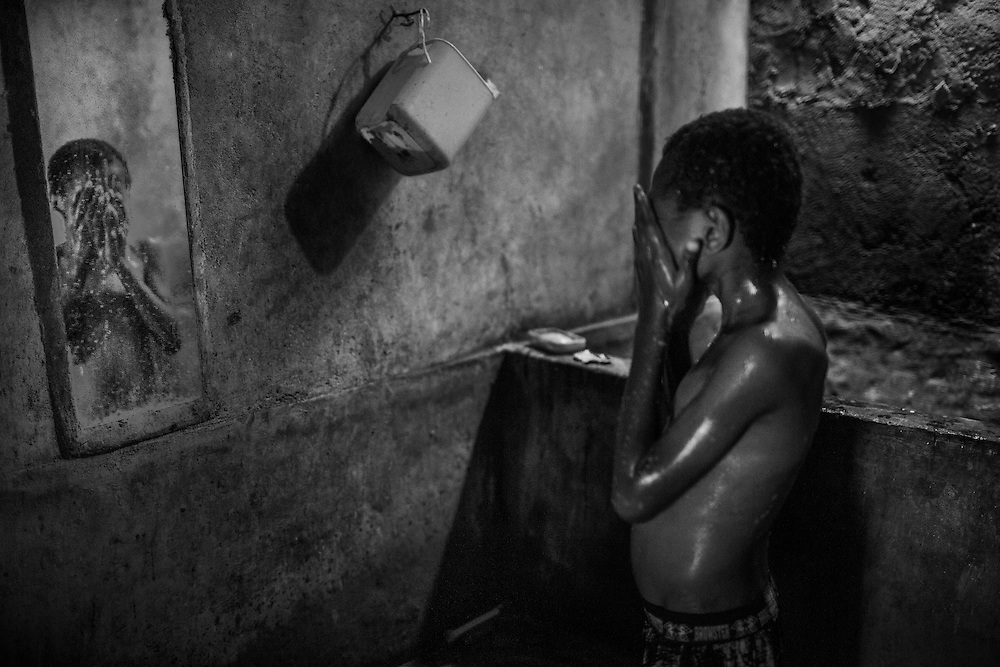 Gary takes a shower as he prepares to go to school. <br /> <br /> Gary is 11 years old and he is HIV-positive.  Gary lost both of his parents to AIDS and he has been taking ARV regularly since the age of four.  Currently, Gary lives with his grandmother and younger cousin.  To support her grandchildren, Gary's grandmother sells betel nut in front of the house earning $2-3 per day.  Due to her meager income Gary's grandmother is unable to buy wholesome and nutritious food and vitamins to help maintain his health and growth.  Last year the Department of Social Services had to suddenly stop providing milk for Gary.  Fortunately, Sorong Sehati, a local community group in Sorong financed by Yayasan San Agustino (YSA), came to the rescue and regularly provides Gary with bread, milk, and monetary assistance to pay for his schooling and transportation to the clinic for check-ups and ARV refills.  At one point, Gary experienced discrimination at school when his teacher forced him to sit in the back to isolate him from the other students.  Sorong Sehati intervened by providing HIV/AIDS education to the schools' faculty including Gary's teacher.  Now Gary sits in the front of the class and he hopes to be a doctor one day so he can help people like him.