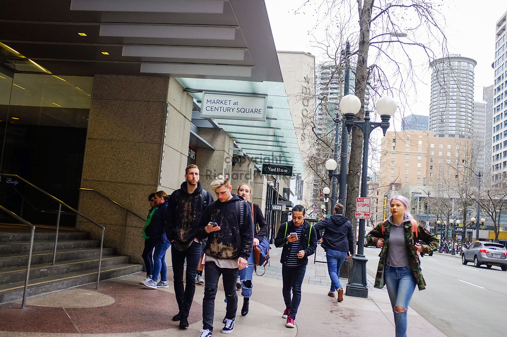 2017 MARCH 05 - People walk south on 4th near Westlake Park, Seattle, WA, USA. By Richard Walker