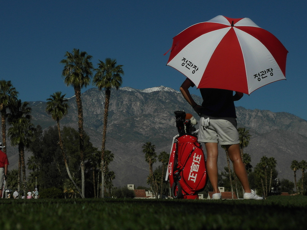 RANCHO MIRAGE, CA - APRIL 1: Sun Young Yoo of South Korea shades herself with an umbrella during the second round of the 2011 Kraft Nabisco Championship at Mission Hills Country Club in Rancho Mirage, California on April 1, 2011. (Photograph ©2011 Darren Carroll) *** Local Caption *** Sun Young Yoo