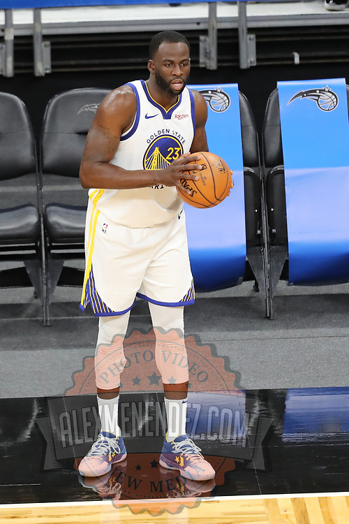 ORLANDO, FL - FEBRUARY 19:  Draymond Green #23 of the Golden State Warriors controls the ball against the Orlando Magic during the second half at Amway Center on February 19, 2021 in Orlando, Florida. NOTE TO USER: User expressly acknowledges and agrees that, by downloading and or using this photograph, User is consenting to the terms and conditions of the Getty Images License Agreement. (Photo by Alex Menendez/Getty Images)*** Local Caption *** Draymond Green