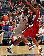 CHARLOTTESVILLE, VA- NOVEMBER 13: Assane Sene #5 of the Virginia Cavaliers drives into Dante Wooten #21 of the South Carolina State Bulldogs during the game on November 13, 2011 at the John Paul Jones Arena in Charlottesville, Virginia. Virginia defeated South Carolina State 75-38. (Photo by Andrew Shurtleff/Getty Images) *** Local Caption *** Assane Sene;Dante Wooten