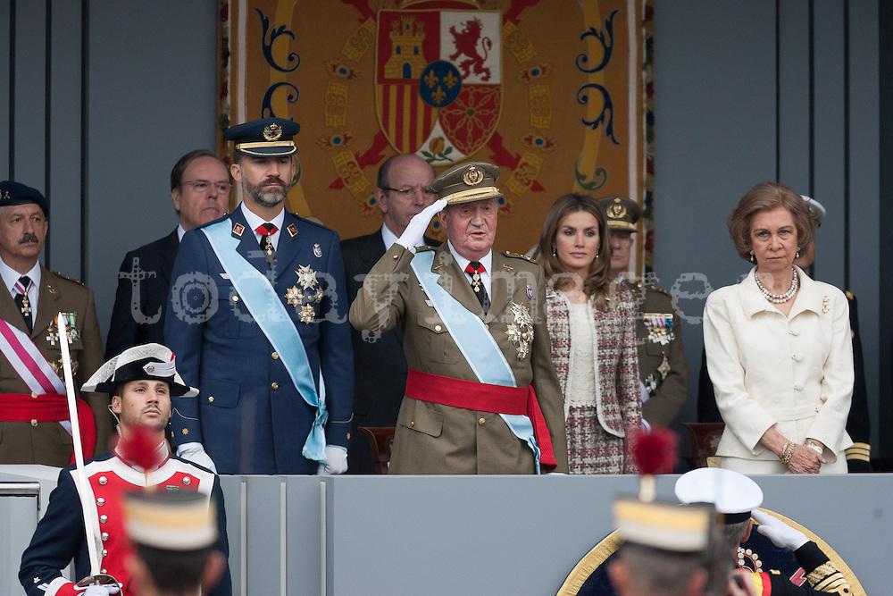 King Juan Carlos I salutes troops