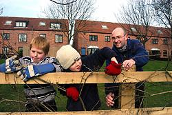 Residents & children volunteer to plant trees on housing association estate; Leeds Yorkshire UK
