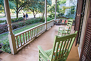 Overlooking South 5th Street in Wilmington, NC lime green rocking chairs offer a relaxing place to visit with neighbors.  PHOTO BY:  JEFF JANOWSKI PHOTOGRAPHY