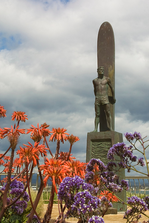 Surf Statue framed by flowers, Santa Cruz, California