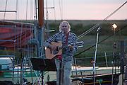 Blakeney, Norfolk, England, 08/08/2009..Sea shanties and folk music on Blakeney harbour front.