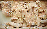 Treasury of Siphnos. Detail of North Frieze depicting the battle between the gods and the Giants. 525 B.C.  Delphi Archaeological Museum. .<br /> <br /> If you prefer to buy from our ALAMY STOCK LIBRARY page at https://www.alamy.com/portfolio/paul-williams-funkystock/greco-roman-sculptures.html . Type -    Delphi     - into LOWER SEARCH WITHIN GALLERY box - Refine search by adding a subject, place, background colour, museum etc.<br /> <br /> Visit our ROMAN WORLD PHOTO COLLECTIONS for more photos to download or buy as wall art prints https://funkystock.photoshelter.com/gallery-collection/The-Romans-Art-Artefacts-Antiquities-Historic-Sites-Pictures-Images/C0000r2uLJJo9_s0