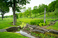 Stonework around  a small stream and spring greens at Firefly Farm Firefly Farm, Hauverville, New York, U.S.A.