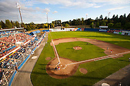 """The Vancouver Canadians Baseball Team play at Nat Bailey Stadium.  Nat Bailey Stadium has often been referred to as the """"prettiest little ballpark in North America"""" - one trip to the 57-year-old stadium and fans start to see why..Spectators are right on top of the action die to the narrow foul territory in the park. They are also treated to one of the few manual scoreboards still in operation as well as the picturesque backdrop of Queen Elizabeth Park..Built in 1951, it was originally named Capilano Stadium after a local brewery. Triple-A class baseball laws not played there until the Vancouver Mounties entered the Pacific Coast League in 1956. After Vancouver's first foray in Class AAA ball ended in 1969, the stadium was used for local soccer and other events."""
