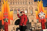 Moscow, Russia, 06/11/2005..People on Red Square in front of decorations erected for a military parade on November 7 to commenorate a similar parade during World War Two when soldiers left for the front.