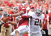 Arkansas receiver Greg Childs, left, makes a catch over Alabama's defensive back Dre Kirkpatrick (21) druing the second quarter of the NCAA college football game with Alabama Saturday, Sept. 25, 2010. Alabama defeated Arkansas 24-20.