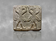 """Hittite relief sculpted orthostat stone panel of Herald's Wall Basalt, Karkamıs, (Kargamıs), Carchemish (Karkemish), 900-700 B.C. Bird-headed, winged figures of human body. Anatolian Civilisations Museum, Ankara, Turkey.<br /> <br /> These figures are called as """"Winged Griffin Demons"""". Embossing is constructed symmetrically. Their hands are on their heads. It is assumed that they carry the heavens. <br /> <br /> Against a grey art background. .<br />  <br /> If you prefer to buy from our ALAMY STOCK LIBRARY page at https://www.alamy.com/portfolio/paul-williams-funkystock/hittite-art-antiquities.html  - Type  Karkamıs in LOWER SEARCH WITHIN GALLERY box. Refine search by adding background colour, place, museum etc.<br /> <br /> Visit our HITTITE PHOTO COLLECTIONS for more photos to download or buy as wall art prints https://funkystock.photoshelter.com/gallery-collection/The-Hittites-Art-Artefacts-Antiquities-Historic-Sites-Pictures-Images-of/C0000NUBSMhSc3Oo"""