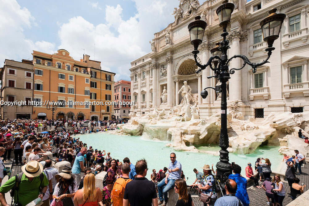 Trevi Fountain or Fontana di Trevia with many tourists in Rome Italy