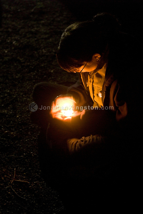 Students and community members gather at a candle light vigil at the  Oregon Holocaust Memorial  throughout the night in Portland Oregon to remember the victims of the Darfur crisis.