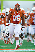 AUSTIN, TX - AUGUST 30:  Desmond Jackson #99 of the Texas Longhorns leads his team onto the field against the North Texas Mean Green on August 30, 2014 at Darrell K Royal-Texas Memorial Stadium in Austin, Texas.  (Photo by Cooper Neill/Getty Images) *** Local Caption *** Desmond Jackson