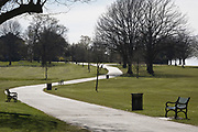As the second week of the UK government's Coronavirus lockdown ends on a fine Spring weekend, and 24hrs after it was reported that 3,000 Londoners had been counted in Brockwell Park, Herne Hill, resulting in the closure of this significant public green space by Lambeth council, an empty path and grass in the park (See an identical view with many people 2 days before in Getty image #1209106121), on 5th April 2020, in London, England.