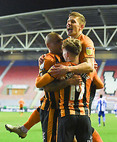 Hull City's Josh Magennis is congratulated on scoring his sides 4th goal<br /> <br /> Photographer Dave Howarth/CameraSport<br /> <br /> The EFL Sky Bet League One - Wigan Athletic v Hull City - Wednesday 17th February 2021 - DW Stadium - Wigan<br /> <br /> World Copyright © 2021 CameraSport. All rights reserved. 43 Linden Ave. Countesthorpe. Leicester. England. LE8 5PG - Tel: +44 (0) 116 277 4147 - admin@camerasport.com - www.camerasport.com