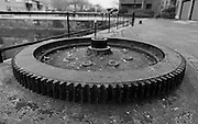 Large gearwheel from machinery from when Bridgwater and Taunton Canal was a working canal, set into a mount on Bridgwater Quay.