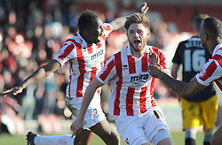 Cheltenham Town's Wes Burns celebrates his goal with team mates - Photo mandatory by-line: Nizaam Jones  - Mobile: 07966 386802 - 07/03/2015 - SPORT - Football - Cheltenham - Whaddon Road- Cheltenham Town v Mansfield - Sky Bet League Two