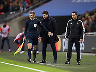 The linesman pushes Tottenham's Mauricio Pochettino out of the way despite him being in his technichal area during the Champions League group match at Wembley Stadium, London. Picture date December 7th, 2016 Pic David Klein/Sportimage
