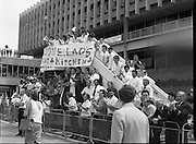 Irish Soccer Team Welcomed Home.   (R81)..1988..19.06.1988..06.19.1988..19th June 1988..After their great success in Germany in Euro 88, the Irish soccer team had a triumphant homecoming. An Taoiseach, Charles Haughey TD and his government were to the forefront of the welcome. Thousands of fans thronged the airport and all the approach roads in the hope of seeing the team. The full squad is as follows..1.GK.Packie Bonner. Celtic.2.DF.Chris Morris. Celtic.3.DF.Chris Hughton  Tottenham Hotspur.4.DF.Mick McCarthy. Celtic.5.DF.Kevin Moran. Manchester United.6.MF.Ronnie Whelan. Liverpool.7.MF.Paul McGrath. Manchester United.8.MF.Ray Houghton. Liverpool.9.FW.John Aldridge. Liverpool.10.FW.Frank Stapleton Derby County.11.MF.Tony Galvin. Sheffield Wednesday.12.FW.Tony Cascarino. Millwall.13.MF.Liam O'Brien. Manchester United.14.FW.David Kelly. Walsall.15.MF.Kevin Sheedy. Everton.16.GK.Gerry Peyton. Bournemouth.17.FW.John Byrne. Le Havre.18.FW.John Sheridan. Leeds United.19.DF.John Anderson. Newcastle United.20.FW.Niall Quinn. Arsenal..Picture shows members of the Aer Lingus flight kitchen in a great vantage point to greet the Irish Soccer Team