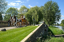 © London News Pictures. 15/05/2016. Windsor, UK. A horse drawn carriage passes over a bridge along the banks of the River Thames on the final day of the 2016 Royal Windsor Horse Show, held in the grounds of Windsor Castle in Berkshire, England. This years event is part of HRH Queen Elizabeth II's 90th birthday celebrations.  Photo credit: Ben Cawthra/LNP