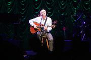 James taylor performing the John Paul Jones arena at the University of Virginia in Charlottesville, VA. 8-17-06. Photo/Andrew Shurtleff