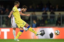 VERONA, Oct. 26, 2017  AC Milan's Hakan Calhanoglu (Back) kicks to score during a Serie A soccer match between AC Milan and Chievo in Verona, Italy, Oct. 25, 2017. AC Milan won 4-1. (Credit Image: © Alberto Lingria/Xinhua via ZUMA Wire)