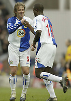 Photo: Aidan Ellis.<br /> Blackburn Rovers v Manchester City. The FA Cup. 11/03/2007.<br /> Rovers Aaron Mokoena is congratulated by Tugay after the first goal