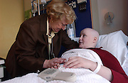 Bedside educator Brigid Higgins is seen with student Eileen Brazil during their class together at Memorial Sloan Kettering Cancer Center in Manhattan, NY. 12/14/2004 Photo by Jennifer S. Altman