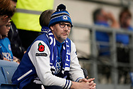 A Peterborough United fan sits watching the team warm up prior to the EFL Sky Bet League 1 match between Oxford United and Peterborough United at the Kassam Stadium, Oxford, England on 16 February 2019.
