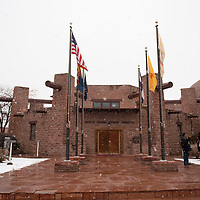 Snow falls on the Navajo Nation Council Chambers, Monday, Jan. 27, the first day of the Navajo Nation Council Winter Session in Window Rock, Arizona.