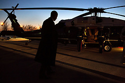 President Barack Obama boards Marine One at the Hope landing zone for departure en route to Chicago O'Hare International Airport in Chicago, Ill., Feb. 19, 2015. (Official White House Photo by Pete Souza)<br /> <br /> This official White House photograph is being made available only for publication by news organizations and/or for personal use printing by the subject(s) of the photograph. The photograph may not be manipulated in any way and may not be used in commercial or political materials, advertisements, emails, products, promotions that in any way suggests approval or endorsement of the President, the First Family, or the White House.