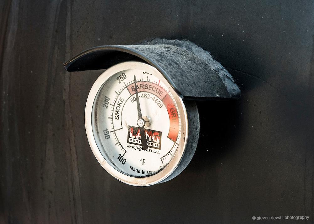 Temperature gauge on a BBQ Smoker.