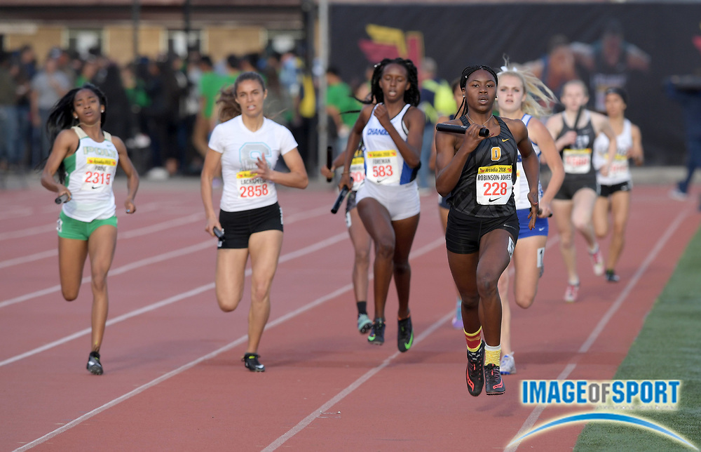 Tierra Robinson-Jones (228) runs the anchor leg on the Bishop O'Dowd girls 800m sprint medley relay that won in 1:44.33 during the 51st Arcadia Invitational in Arcadia, Calif., Friday, April 6, 2018.