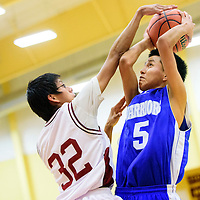 011215  Adron Gardner/Independent<br /> <br /> Rehoboth Lynx Anthony Francis (32) gets a hand on a jump shot by  Navajo Pine Warrior Francis Nez (5) at Rehoboth High School Monday.