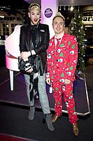 Lewis-Duncan Weedon,  watching John Galea performing  festive songs at the Yamaha Store in Soho, London.