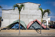 2016/10/10 – Bahia de de Caráquez, Ecuador: Two makeshift tents on the side walk in Bahia de Caráquez, Ecuador, 10th October 2016. Bahia is a beach touristic destination, specially to Ecuadorians from the mountains, but after the 16th April earthquake most of the city was damaged and destroyed leaving many locals living in provisional homes all around the city. (Eduardo Leal)