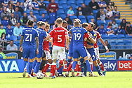 Cardiff City defender Sean Morrison (4) almost comes to blows with Bristol City's Chris Martin (9) during the EFL Sky Bet Championship match between Cardiff City and Bristol City at the Cardiff City Stadium, Cardiff, Wales on 28 August 2021.