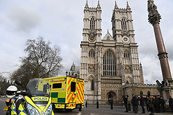 Ambulances by Westminster Abbey, London, after policeman has been stabbed and his apparent attacker shot by officers in a major security incident at the Houses of Parliament.
