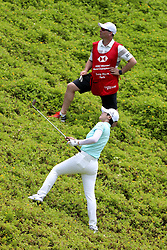 March 2, 2019 - Singapore - Sung Hyun Park, bottom, of South Korea plays a shot on the 8th hole as her caddie, David Jones, looks on during the third round of the Women's World Championship at the Tanjong Course, Sentosa Golf Club. (Credit Image: © Paul Miller/ZUMA Wire)