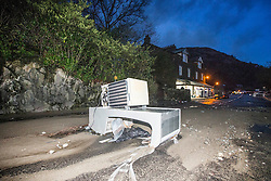 © Licensed to London News Pictures. 10/12/2015. Glenridding UK. A fridge lays in the road as diggers are trying to clear the beck of rocks in The village of Glenridding in Cumbria that has flooded for a second time this week after the beck broke it's banks. Photo credit: Andrew McCaren/LNP