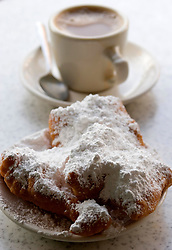 16 December, 05. New Orleans, Louisiana.  <br /> Cafe du Monde, famous for Beignets and coffee is back and open for business. Locals and tourists alike love the delicious beignets, covered in powdered sugar and good tasting coffee.<br /> Photo; ©Charlie Varley/varleypix.com