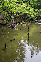 Pond Garden atDoukutsu Kannon Tokumei-en - Doukutsu Kannon Tokumei-en - Tokuzo Yamada decided to construct a sacred grounds that people could come together to enjoy. Construction began in 1919, and Yamada continued to invest his own private fortune in it. The sacred underground temple was completed without the help of modern machinery, using pickaxes, shovels, and sheer manpower to dig out the mountain, fill in the valley, excavate the pond, and haul the stones.  Tokumei-en was built simultaneously alongside Doukutsu Kannon, and is considered one of the finest Japanese gardens in the northern Kanto area. The garden is known for its unique rising and falling landscape, but it was built on what was originally an even slope. Earth dug out in the construction of the cave was used to create the garden's undulating quality.  The garden was originally built for Yamada's personal enjoyment and not open to the public as it is now. When spring begins, it is full of azaleas, mountain cherries, and brilliant fresh verdure. In summer come the hydrangeas, and its glorious autumn leaves are renowned