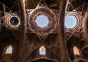 Stunning photographs reveal the beautiful ceilings in Iran's mosques, bazaars and public baths<br /> <br /> For the past few decades, restrictions on travel to Iran has meant the country has been largely shut off from the Western world, butas visa sanctions are lifted in the light of a landmark nuclear deal, the local tourism industry is hoping for a flurry of visitors.<br /> It's not hard to see why Iran is listed as one of the top travel destinations of 2016, with its rich culture and history.<br /> Among the standout aspects of the nation is its beautiful ancient architecture, with the cities and towns littered withornate and eye-catching mosques, public baths and markets.<br /> And unlike many other countries - the roof is not an afterthought, with many ceilings built as the centrepiece to the building, with many of the tile designs showcasing a display of intricate geometric patternsthatdate back several centuries.<br /> French photographerEric Lafforgue has travelled the country photographing the ceilings of indoor markets, mosques and bath houses.<br /> <br /> Photo shows: Ceiling With Its Intricate And Elaborate Patterns Of The Old Bazaar