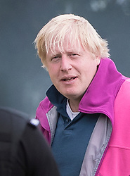 © Licensed to London News Pictures. 10/06/2017. Oxford, UK. Foreign Secretary Boris Johnson is seen at his Oxfordshire home talking to armed police.Theresa May has formed a minority government with the support of the DUP after failing to gain enough seats in the general election. Photo credit: Peter Macdiarmid/LNP