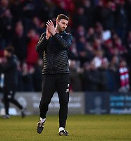 Lincoln City's first team coach/under 23 manager Jamie McCombe applauds the fans at the final whistle<br /> <br /> Photographer Andrew Vaughan/CameraSport<br /> <br /> The EFL Sky Bet League Two - Lincoln City v Northampton Town - Saturday 9th February 2019 - Sincil Bank - Lincoln<br /> <br /> World Copyright © 2019 CameraSport. All rights reserved. 43 Linden Ave. Countesthorpe. Leicester. England. LE8 5PG - Tel: +44 (0) 116 277 4147 - admin@camerasport.com - www.camerasport.com