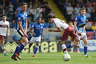 Bradford City midfielder Timothee Dieng (8)  glancing header during the EFL Sky Bet League 1 match between Rochdale and Bradford City at Spotland, Rochdale, England on 21 April 2018. Picture by Mark Pollitt.