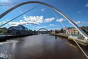 A general view of the King Edward Bridge and High Level Bridge as well as Tyne river of Newcastle from the Gateshead Millennium Bridge taken on Tuesday, March 16, 2021. It is a pedestrian and cyclist tilt bridge spanning the River Tyne between the Gateshead arts quarter on the south bank and the Quayside of Newcastle upon Tyne on the north bank. (Photo/ Vudi Xhymshiti)