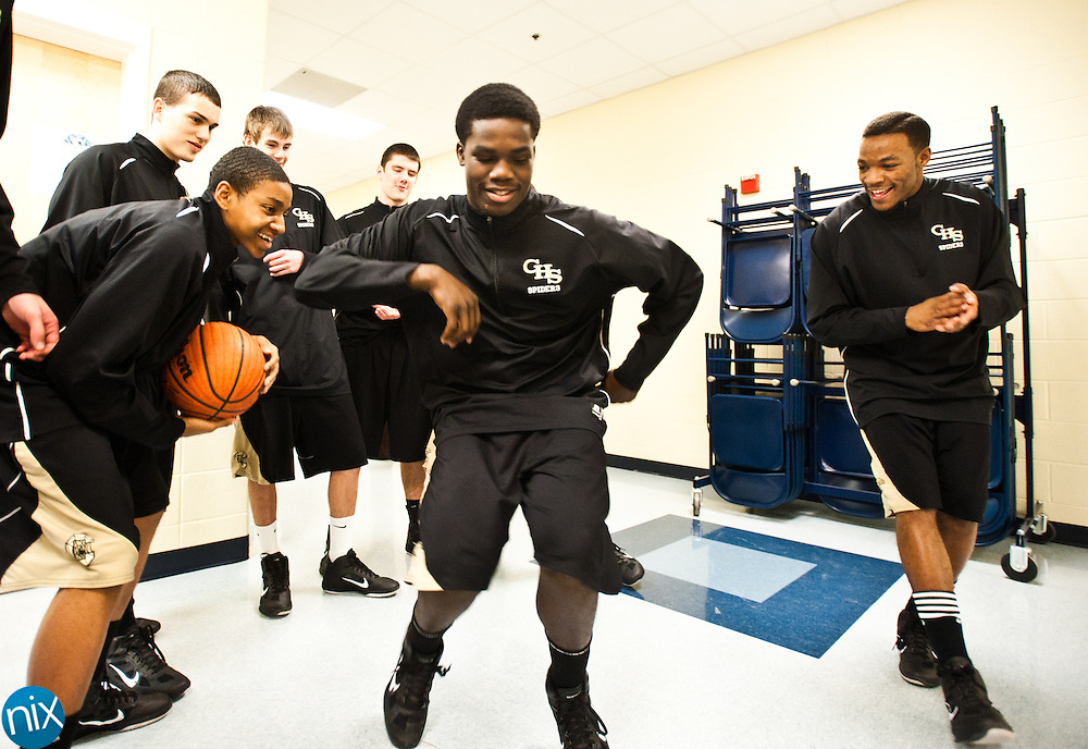 The Concord boys basketball team loosen up prior to a game against Hickory Ridge Tuesday night in Harrisburg. The Ragin' Bulls defeated Concord 68-59. (Photo by James Nix)